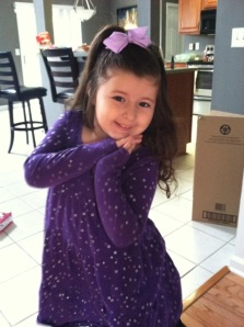 Arianna strikes a pose in a very fashionable ensemble.