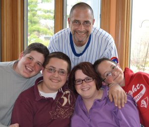 Paula with her husband and three sons, Mason, Joshua and Adin.