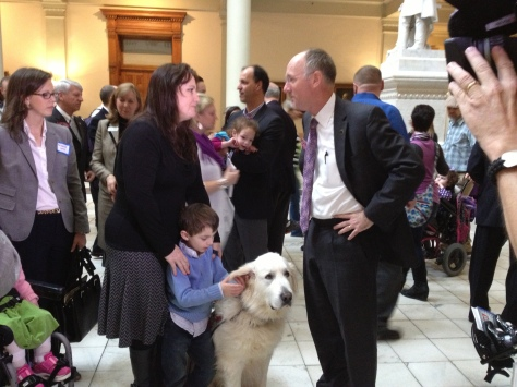Wendi Scheck with son Hudson and Rep. Allen Peake (and service dog Denali).