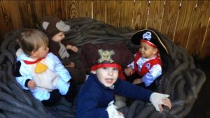 Connor in the cow costume, Malcolm as the monkey, Max as the big pirate, and their friend David the pirate.