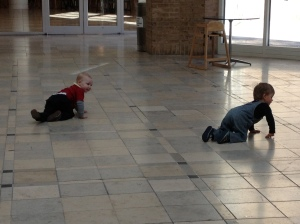 Malcolm doesn't mind crawling around with Connor, even though he can walk already.