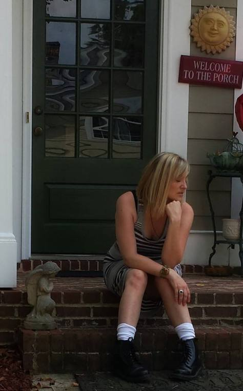 Kim sits on the front porch of her Georgia home, possibly for the last time, as they plan to put it on the market due to the expense of maintaining two households.